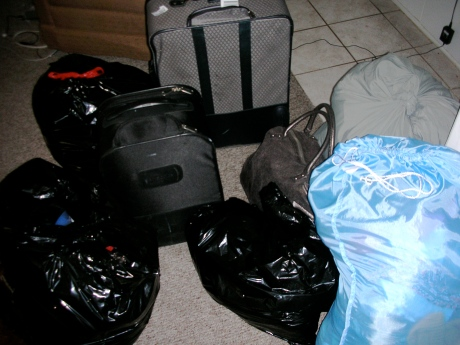 Three garbage bags, two laundry bags, one suitcase and two carry-ons. Of motherf*cking tight pants! (And some other things, like monocles and spats.)